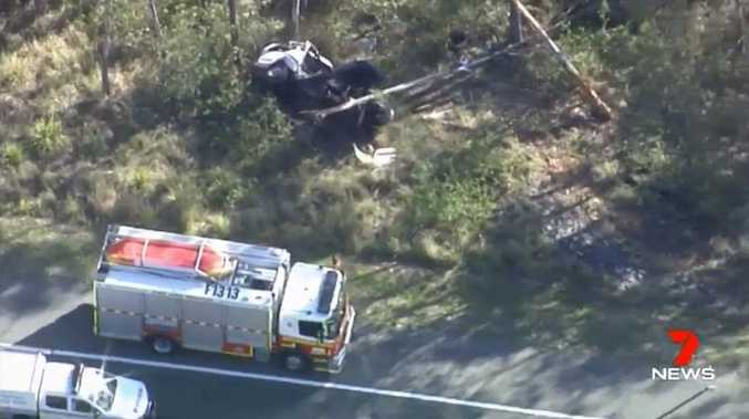 Emergency services at the scene of a fatal traffic crash near Coulson on Tuesday morning.