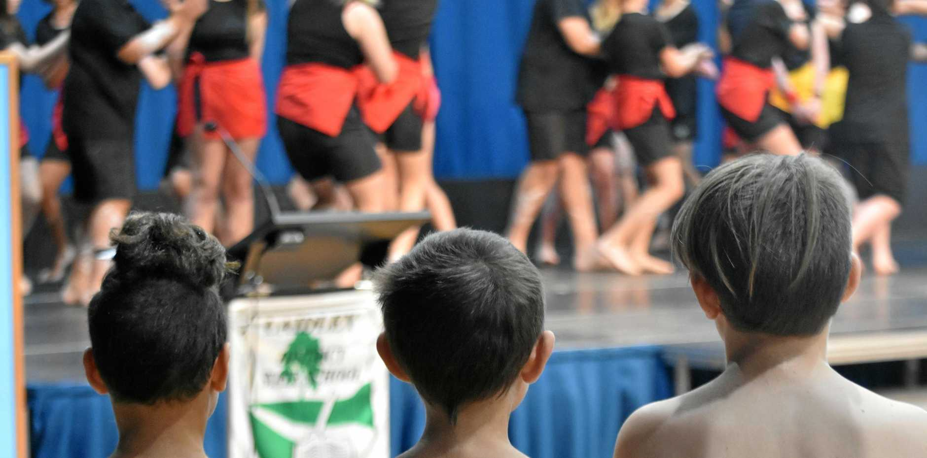 CELEBRATION: Laidley District State School students watch on as the Laidley State High School Dance Troupe performs.