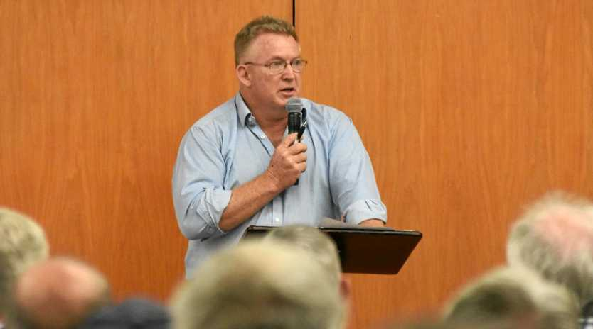 GRAVE CONCERNS: Lockyer Water Users Forum chairman Paul Emmerson speaks at the open meeting concerning groundwater allocations in the Central Lockyer in Gatton on Thursday night.