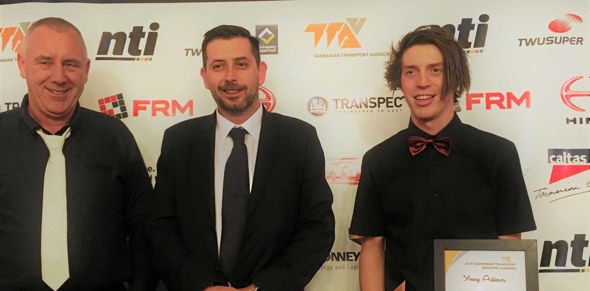 TOP HONOUR: Seton Broomhall (far right) receives his award at the Tasmanian Transport Association gala dinner.