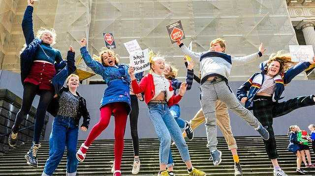 Kids from central Victoria launch the Schools Strike 4 Climate Action on the steps of parliament house.