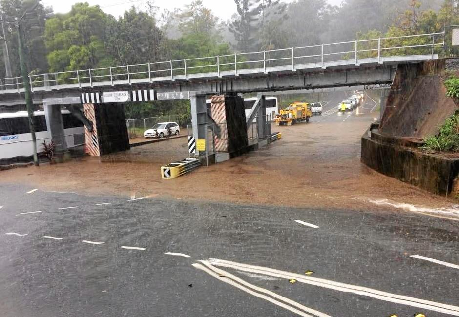 Wild weather on the Coast has caused flash flooding at Palmwoods, with the Railway Bridge going under this afternoon.