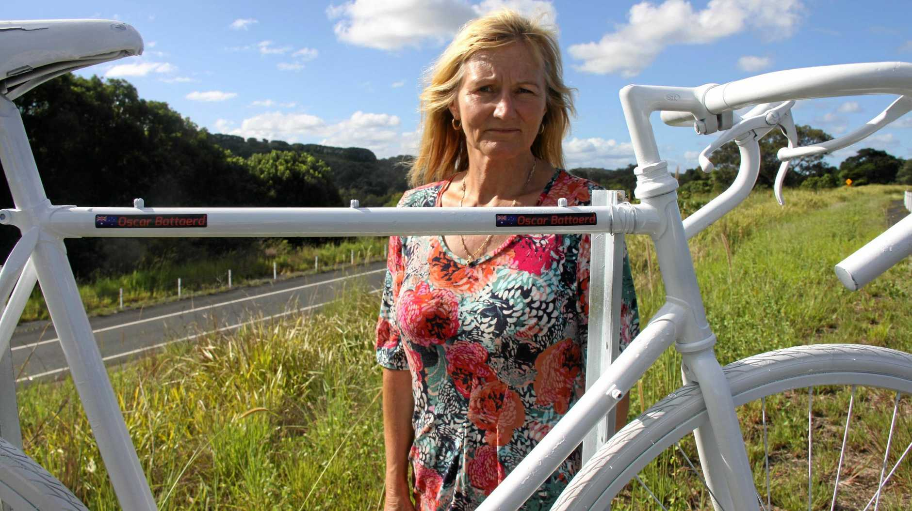 Cheryl Battaerd with the ghost bike erected as a memorial to her husband.