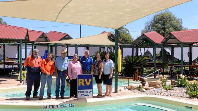 Maranoa Regional Council Deputy Mayor Jan Chambers and  Campervan and Motorhomes Club of Australia director Richard Mainey declare Mitchell RV friendly. (From left) John Tate, Darren Kay, Jeff Watson, Cr Chambers, Mr Mainey, Bree Jiggins and Jane Fenton,
