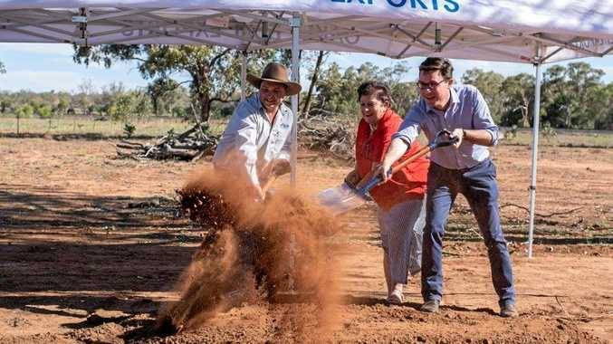 MUCKING IN: Daniel Meacham of Oakey Beef Exports, Mayor Annie Liston and Agriculture Minister David Littleproud turn the sod at the site of the future Morven Freight Hub.