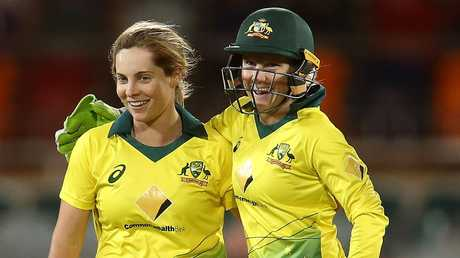 (L-R) Sophie Molineux and Alyssa Healy celebrate Twenty20 victory over New Zealand at Manuka Oval on October 5 in Canberra. Picture: Getty Images