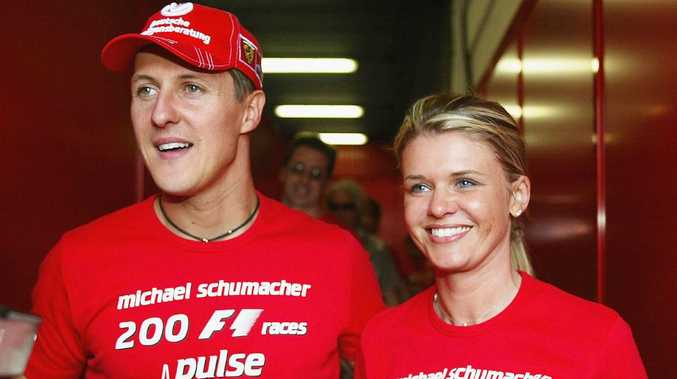 BARCELONA, SPAIN - MAY 9: Michael Schumacher of Germany and Ferrari celebrates with his wife Corrina after competing in his 200th Grand Prix during the Spanish F1 Grand Prix on May 9, 2004, at the Circuit de Catalunya in Barcelona, Spain. (Photo by Getty Images)