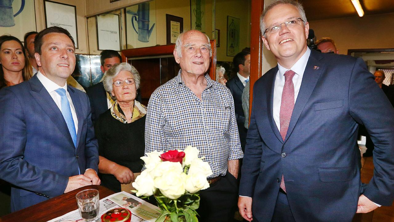 Morrison paid his respects with Victorian Opposition Leader Matthew Guy by visiting the cafe of Sisto Malaspina. Picture: Michael Dodge/Getty Images