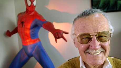 Stan Lee with one of his most famous creations, Spider-Man. Picture: AP Photo/Reed Saxon, File