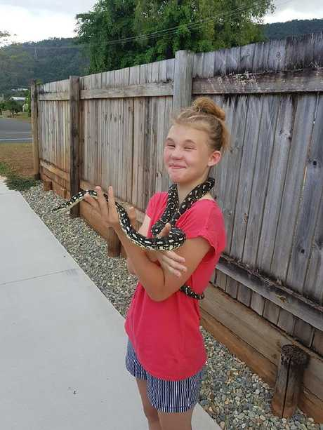 Amelia Farquis with her pet jungle python Amy after being reunited with the snake.