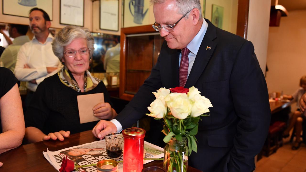 Mr Morrison meeting with Mr Malaspina's business partner Nino Pangrazio. Pic: Jake Nowakowski
