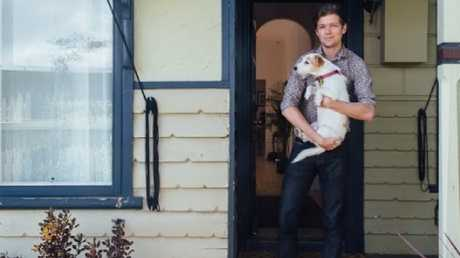 Freddy Grant (pictured with Grungle the dog) bought his first home with husband Burton Reynolds in Footscray in Melbourne last year. Picture: Megan George, Bluethumb