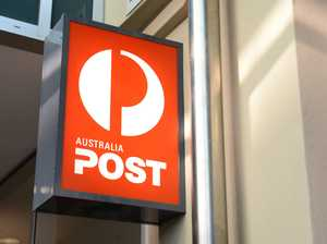 Australia Post courier battles trailer in CCTV footage