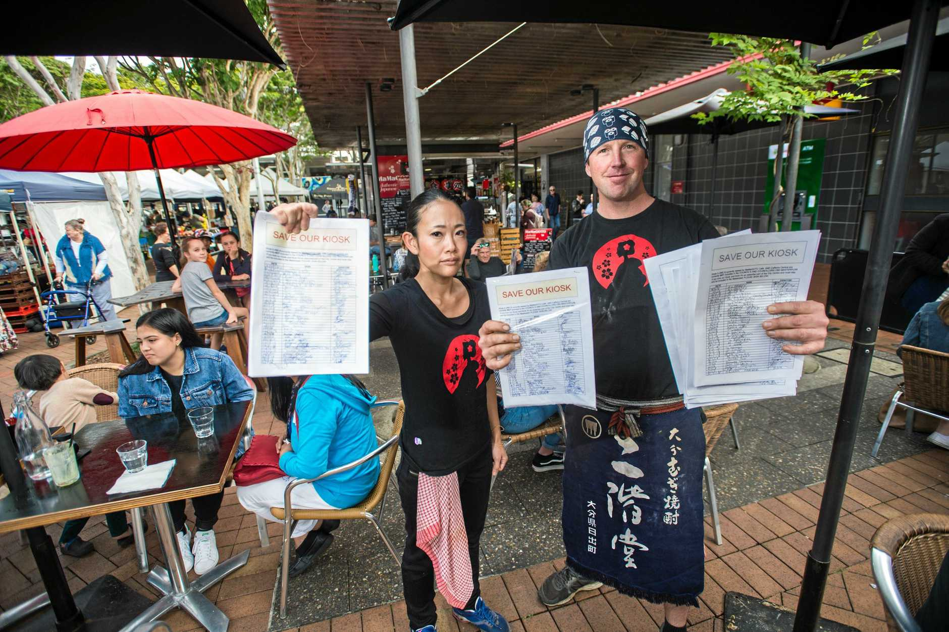 FIGHTERS: Yukari and Heath Keizer with the petition to save their business.