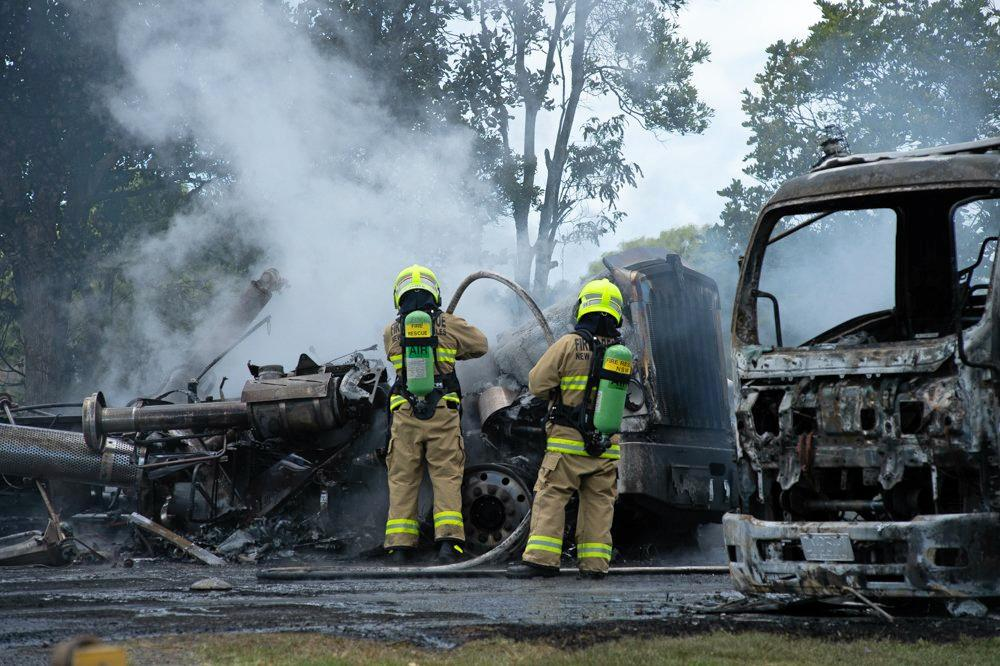 Firefighters at the scene of the crash on Tweed Valley Way yesterday.