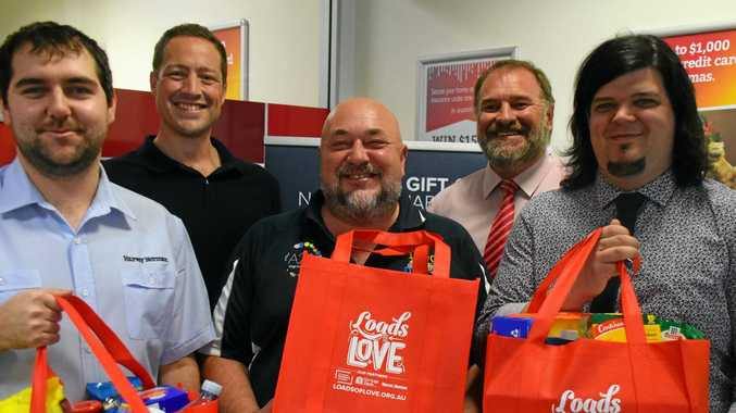 LOADS OF LOVE: Ryan Maxwell, Matt Gregg, Jim Bennett, Craig Jones and Brendan Young are ready to collect non-perishable items to help make Christmas brighter for those doing it tough.