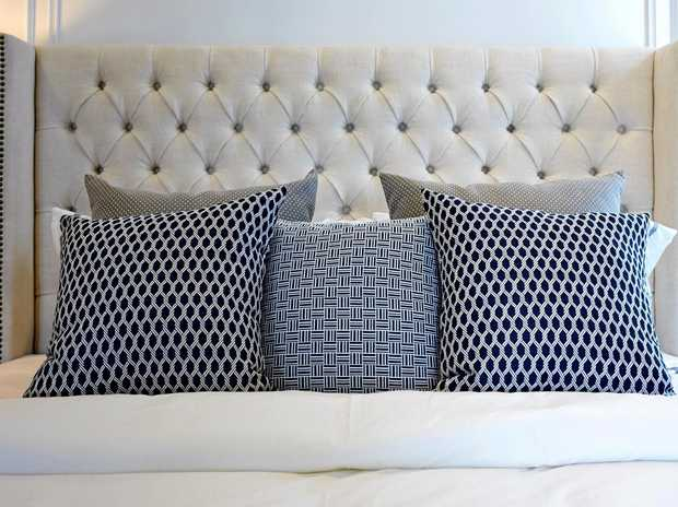 Add interest and style with brass upholstery tacks.