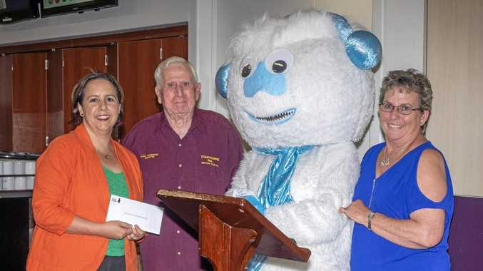 Robyn Henderson and Snowflakes Mascot on behalf of Snowflakes in Stanthorpe from Jean Hallas Secretary/Manager on the board of Stanthorpe RSL Club and Cyril Charlwood President of the board for the Stanthorpe RSL Club.