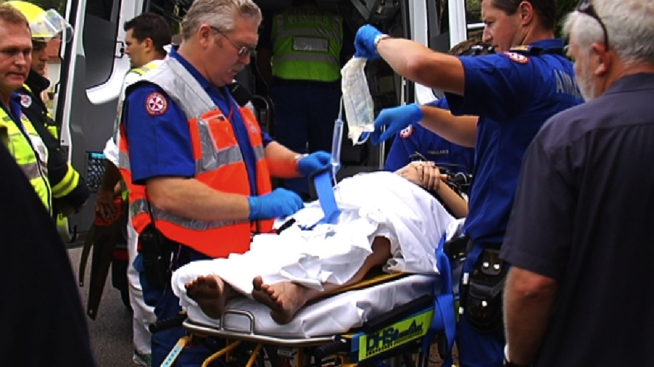 Ambulance officers treat Brodie Donegan after her car was hit by a drug driver on Christmas Day in 2009.