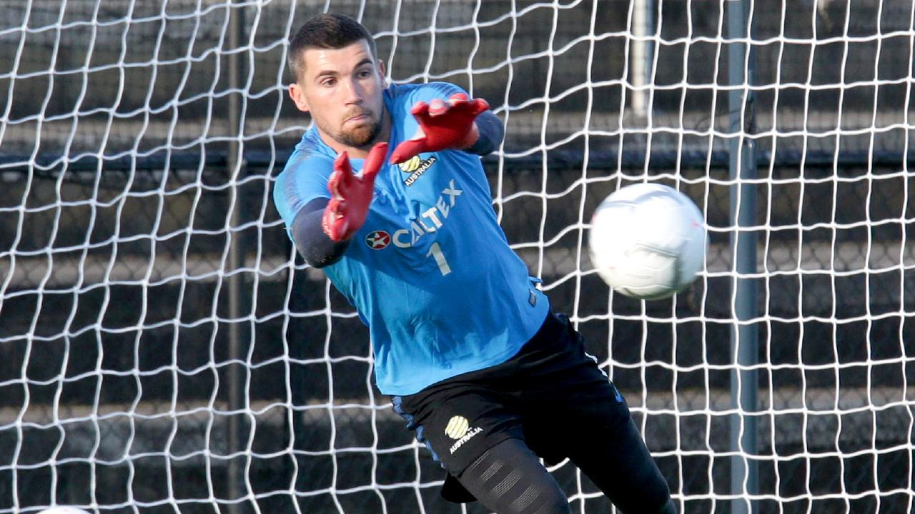 Mat Ryan dives into his work at training. (AAP/Image Steve Pohlner)