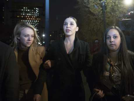 """Emma Coronel, centre, the wife of Joaquin """"El Chapo"""" Guzman leaves court after opening arguments in the trial of the Mexican drug lord. Picture: AP"""