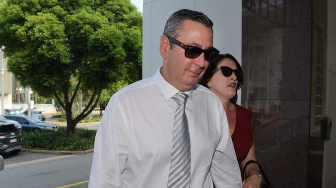 Former Elders real estate agent Chris Deutrom enters the NT Supreme Court with his wife, Helen