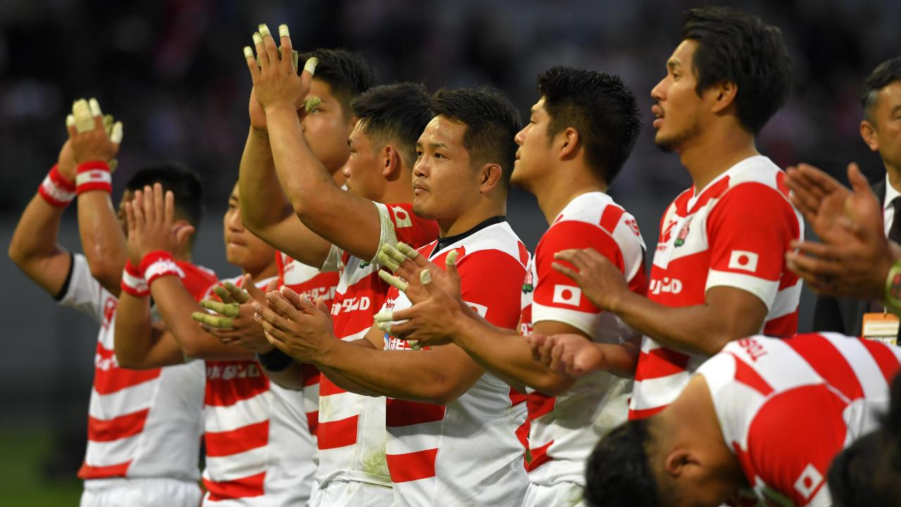 Japanese players applaud fans after a match against the All Blacks. Picture: Getty Images