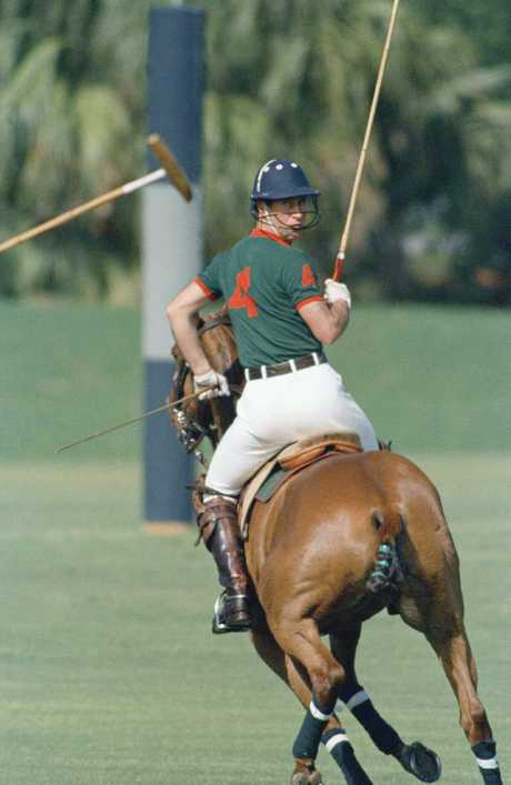Prince Charles looks over his shoulder as he plays in the first Prince of Wales Cup polo match at the Windsor Polo and Beach Club in Vero Beach, USA in 1969. Picture: AP