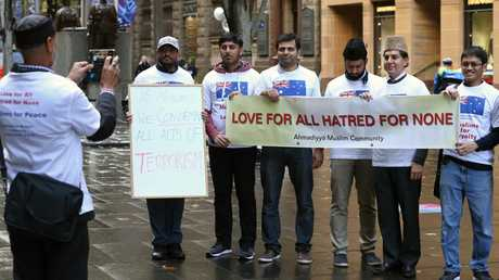 Muslims from the Ahmadiyya Muslim Community pay their respects to the victims of terrorism in a peaceful display in Martin Place, Sydney. Picture: Toby Zerna
