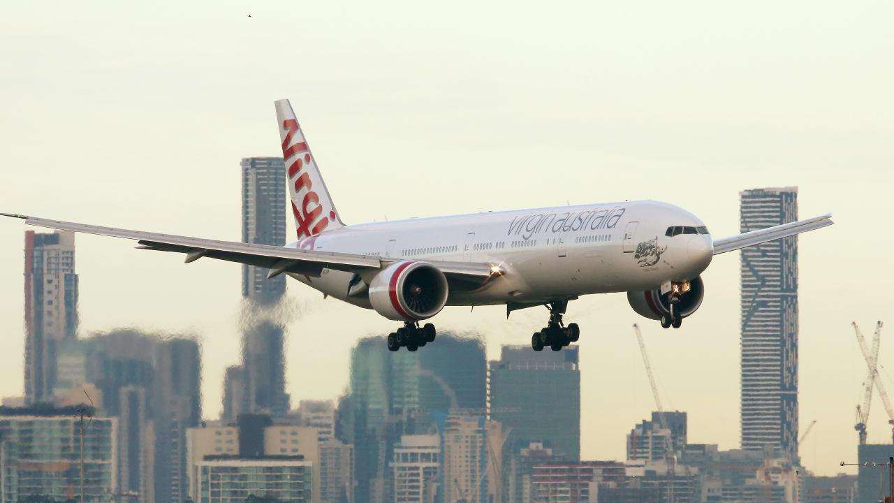 Virgin Australia plane landing at Brisbane Airport. Picture: Liam Kidston