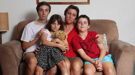 Catherine Frewer, widow of cyclist Cameron Frewer, with their three kids Lachlan, Heidi and Oscar. Picture: Peter Wallis