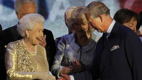 Queen Elizabeth II shakes the hand of her son Prince Charles at the end of the Queen's Jubilee Concert in front of Buckingham Palace, London. Picture: AP