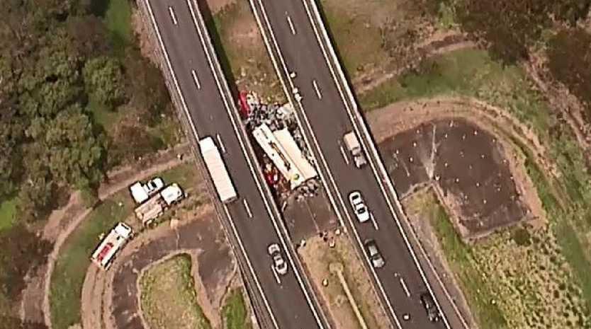 A semi-trailer has come off the Logan Motorway at Tanah Merah, south of Brisbane.