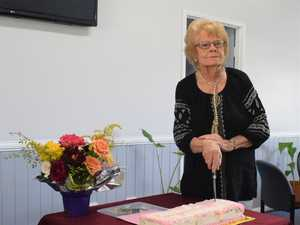Gwen Willmington cutting her birthday cake on