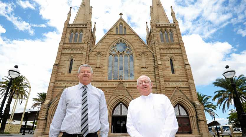 LIGHTS AWAY: TCC principal Rob Alexander and Father Bryan Hanifin at St Joseph's Cathedral.