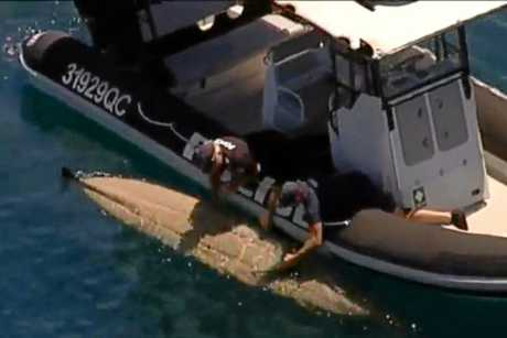 Police have retrieved a kayak after a man was knocked into the water by a large tiger shark off Moffat Beach this morning.