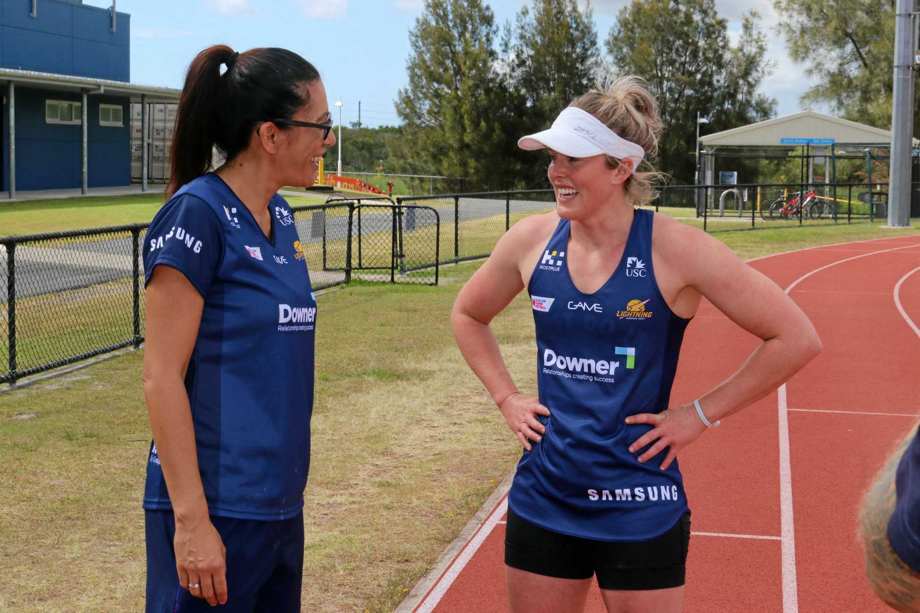 Sunshine Coast Lightning's Laura Scherian gets busy in pre-season training as coach Noeline Taurua watches on.