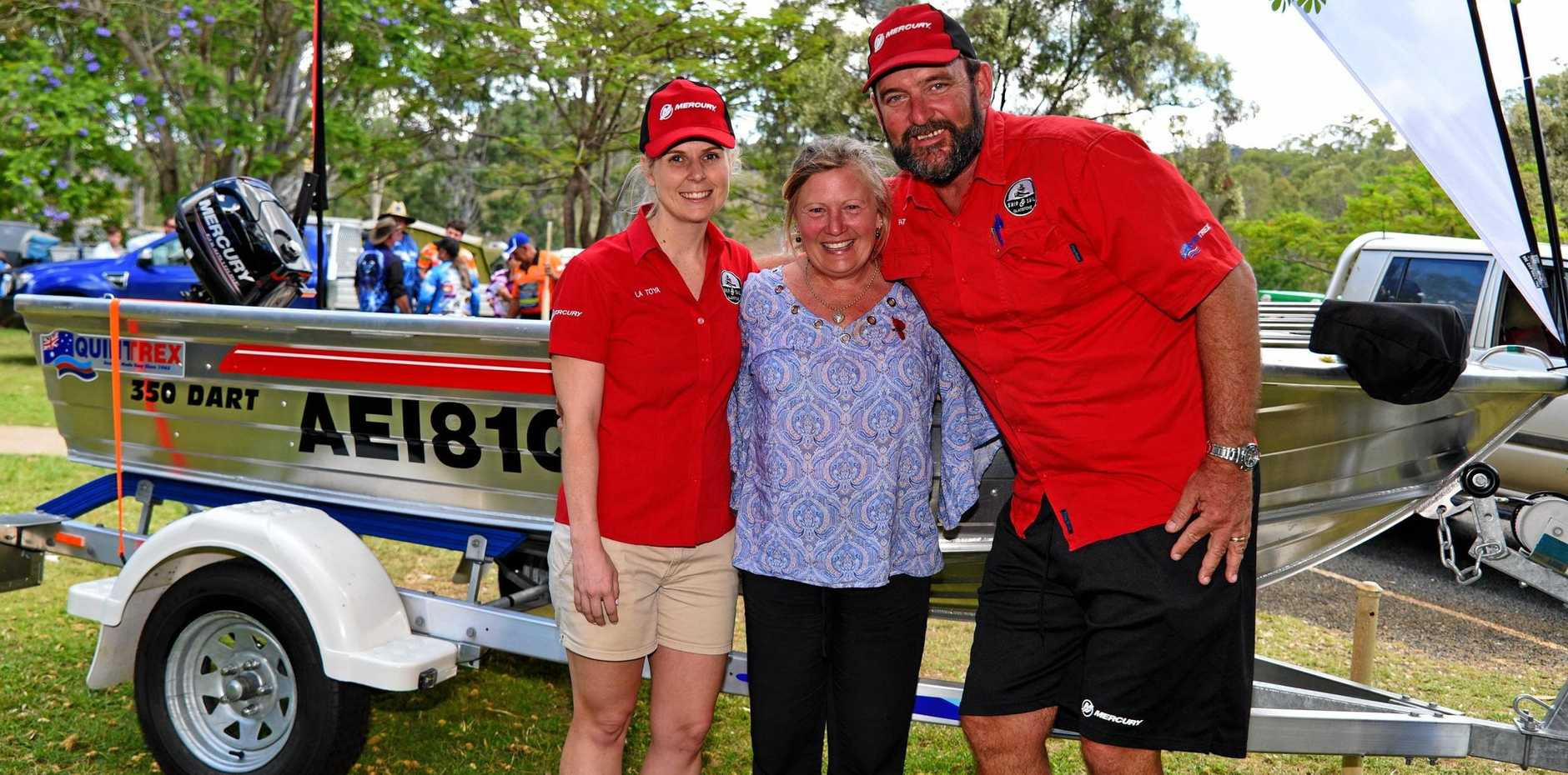 Ship and Sails' La Toya Reynolds and Patrick Laws with Leesa Giles who won the major prize, a 350 Quintrex Dart.
