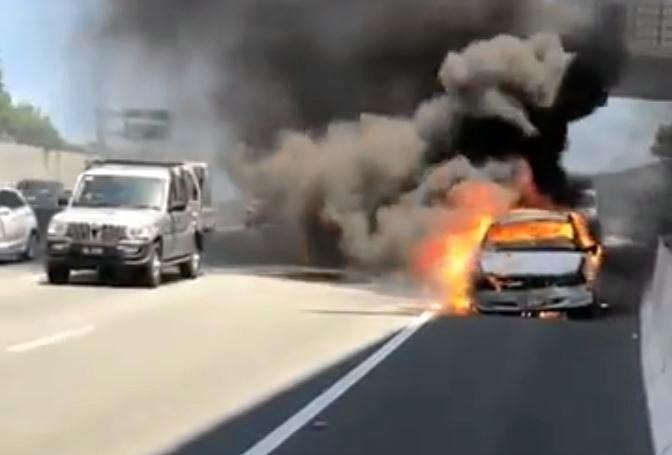 A  car was engulfed in flames after it overheated at Banora Point.
