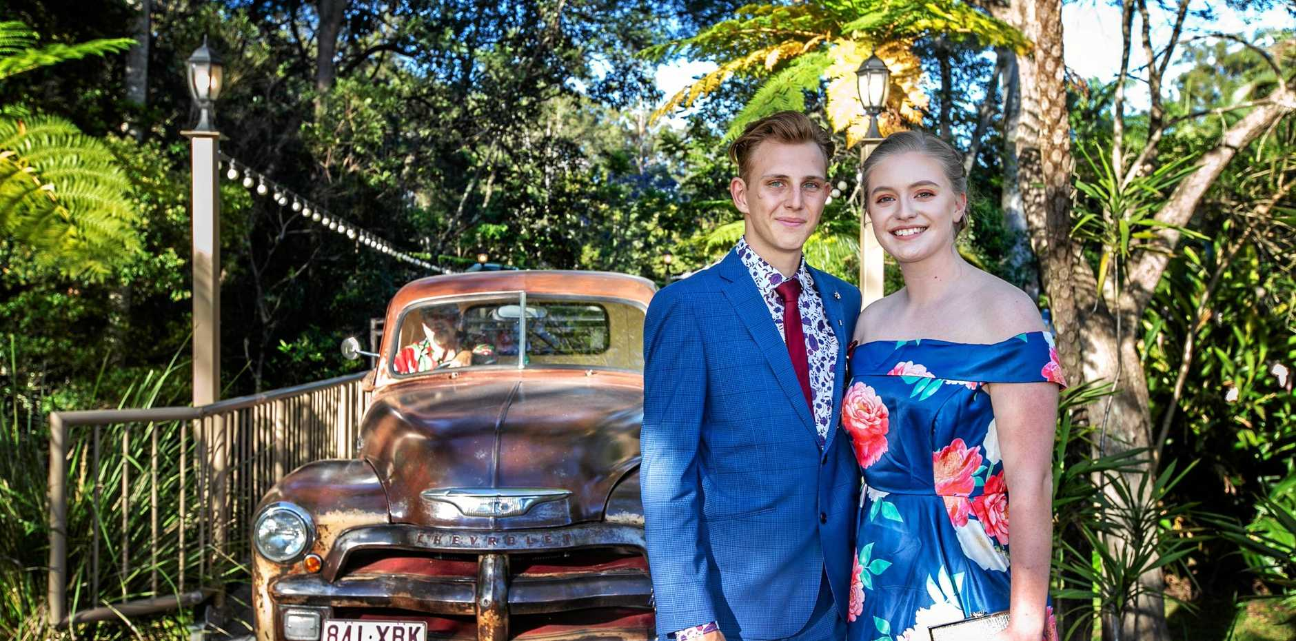 FANCY: Caspian Blackwell-Barnes and Lily Marks arrive in style to the Tweed Valley Adventist College formal.