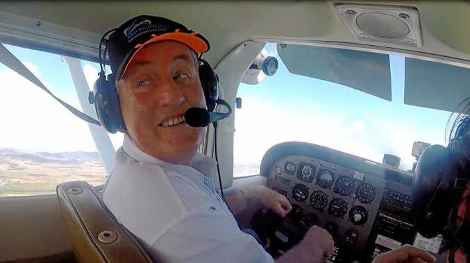 FLYING HIGH: Mayor Greg Williamson piloting a Cessna 172 over Mackay on Thursday morning.