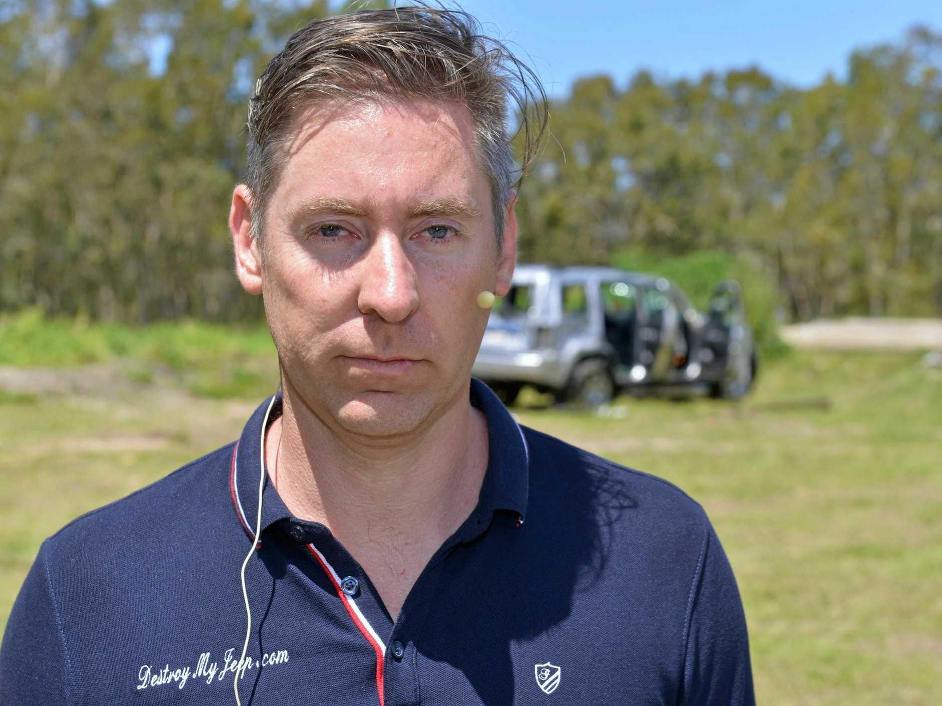 DESTROY MY JEEP: Ashton Wood destroys his Jeep to raise awareness of vehicle lemon laws.  Photo: John McCutcheon / Sunshine Coast Daily