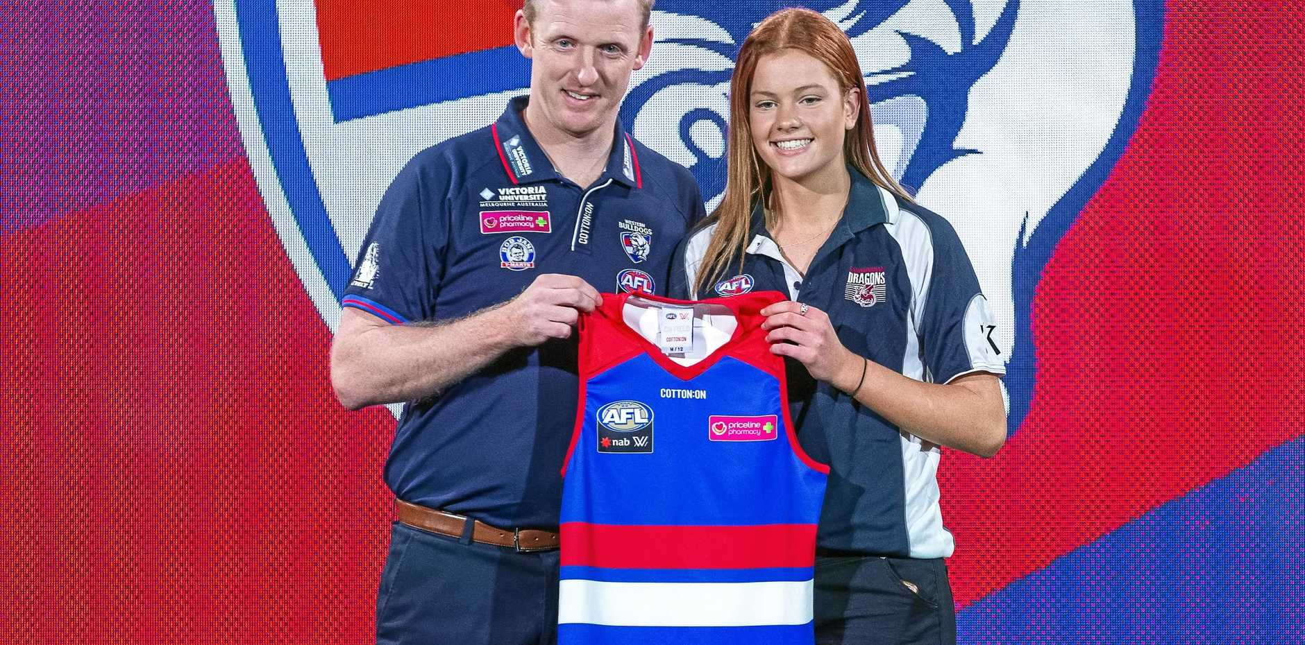 Bulldogs head coach Paul Groves and No.10 pick Eleanor Brown at the 2018 AFLW Draft in Melbourne last month. Picture: Daniel Pockett/AAP