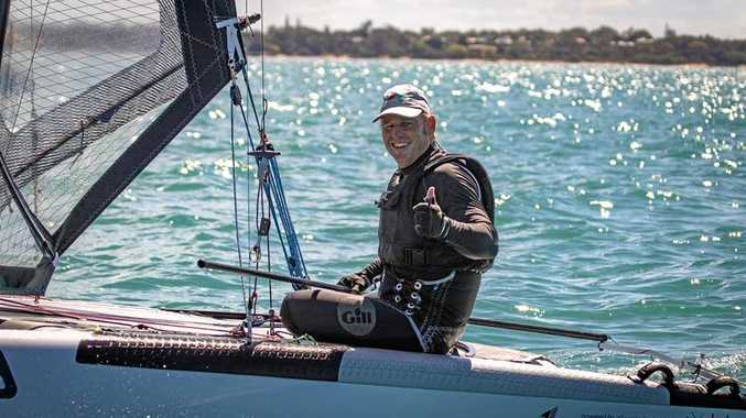 Andrew Landenberger celebrates after taking out the A-Class Catamaran Australian Classics title at Hervey Bay.