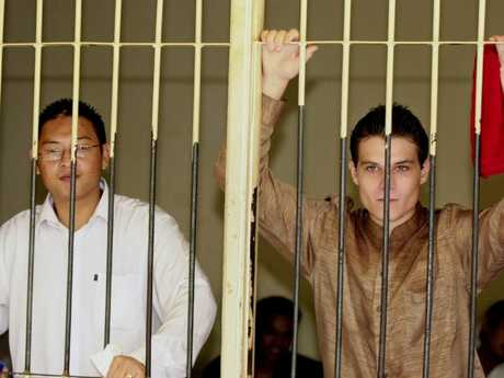 Rush, right, awaiting trial with Bali Nine king pin Andrew Chan, who was executed by firing squad three years ago. Picture: Firdia Lisnawati.