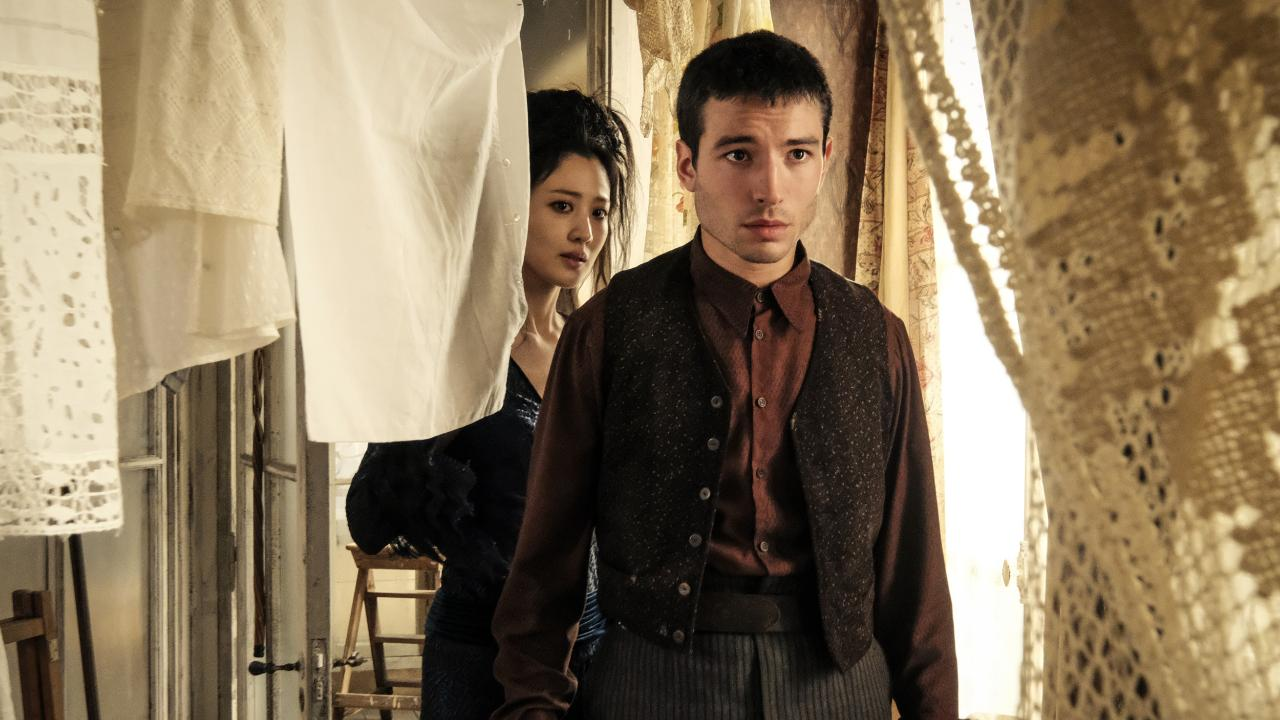 This image released by Warner Bros. Pictures shows Claudia Kim, left and Ezra Miller in a scene from 'Fantastic Beasts: The Crimes of Grindelwald'. Picture: Jaap Buitendijk/Warner Bros/via AP