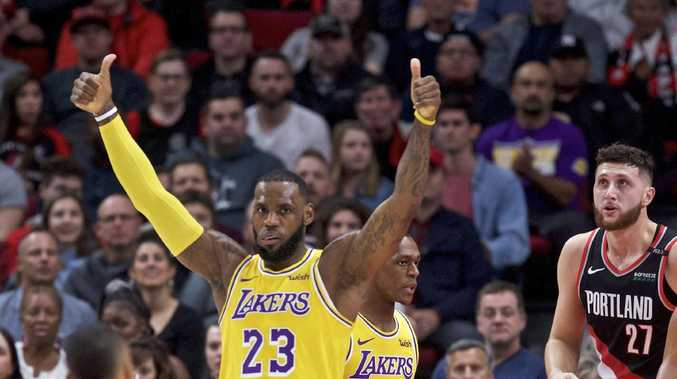 Los Angeles Lakers forward LeBron James gestures against the Portland Trail Blazers during the first half. Picture: Craig Mitchelldyer/AP