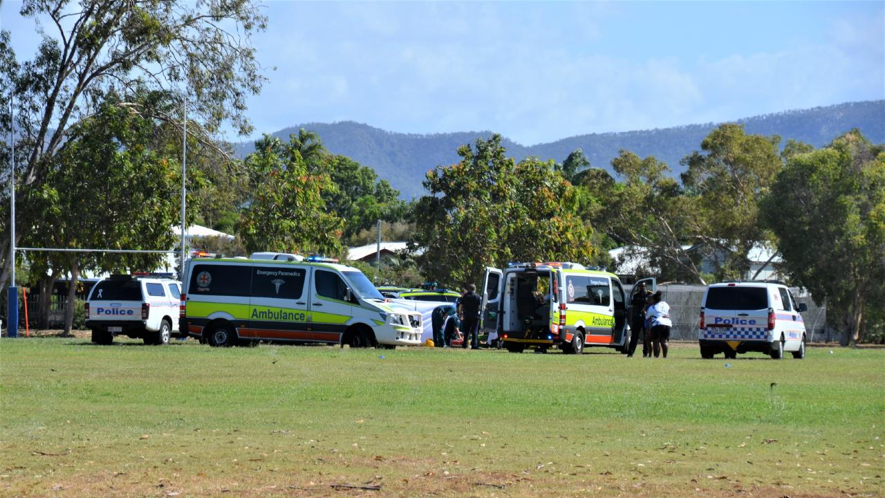 Police and paramedics at Townsville State High School.