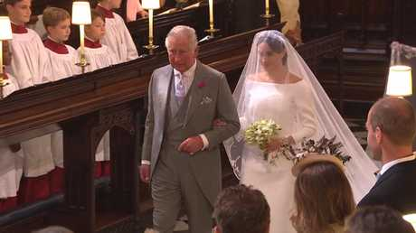 A magical moment, Charles arrived Meghan down the passage. Picture: BBC