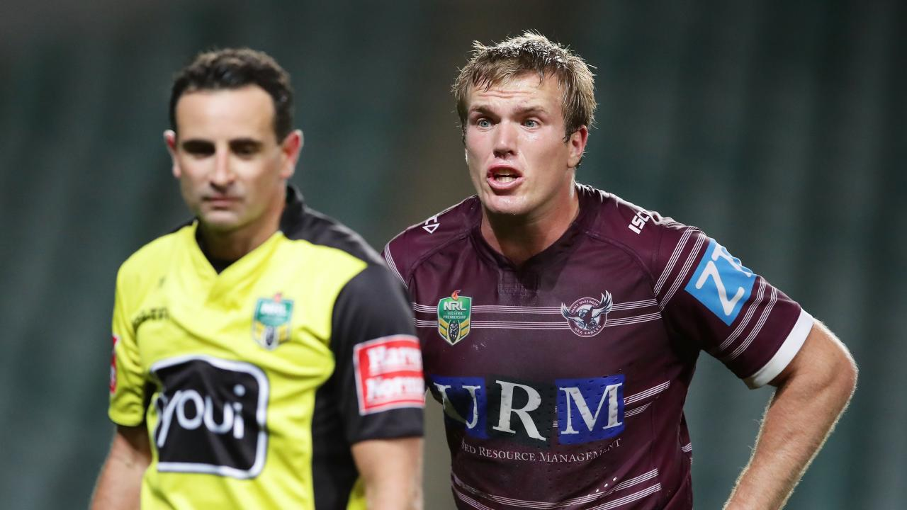 Jake Trbojevic of the Sea Eagles argues with referee Gerard Sutton.